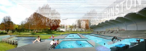Vue sur Les Bains Johnston. Les bassins intérieurs et extérieurs profitent d'un système de bassins filtrant naturels.